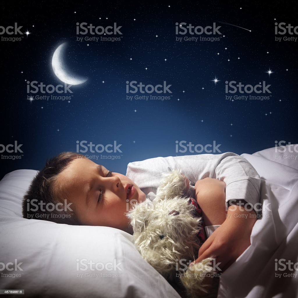 Boy sleeping and dreaming stock photo
