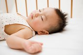 Boy sleeping in crib
