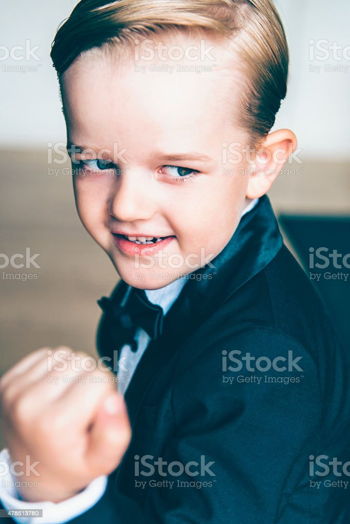 Boy smiles and makes a fighting stance stock photo