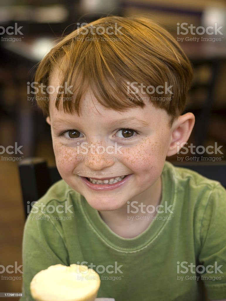 Boy Smiling in Restaurant & Child Eating Ice Cream Cone royalty-free stock photo