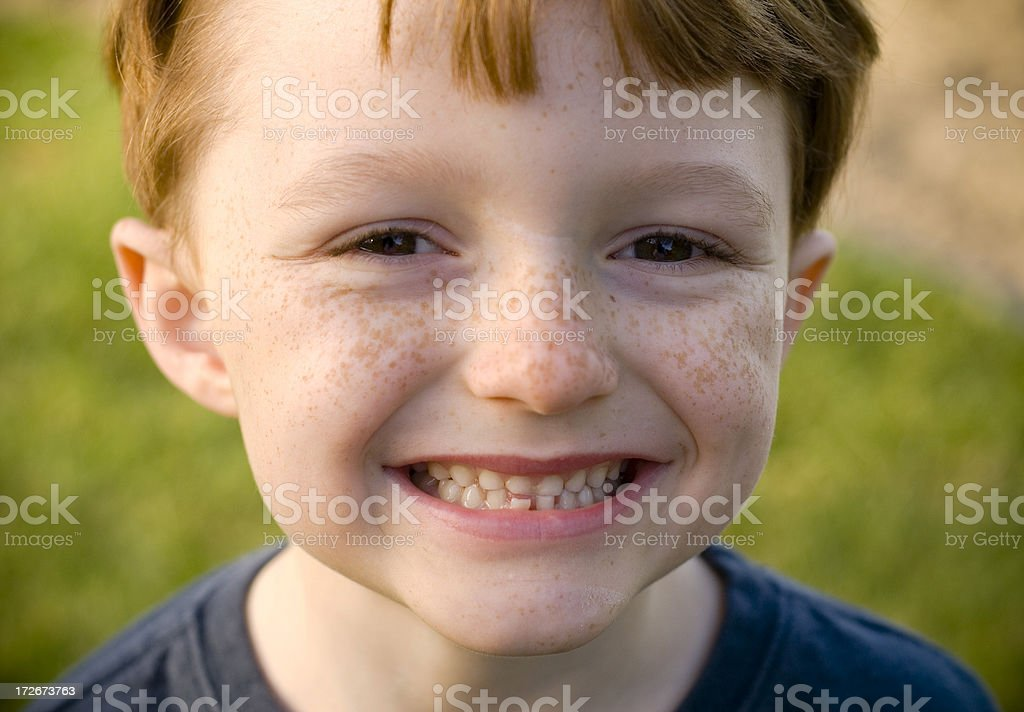 Boy Smiling with Loose Tooth, Happy Redhead Freckle Face Child stock photo