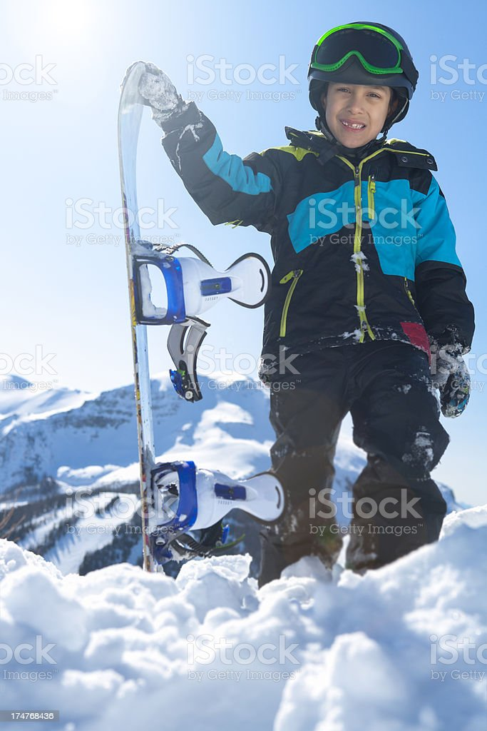 Boy snowboarder at the mountain stock photo