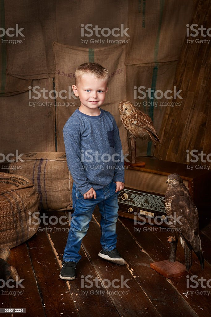 Boy standing and looking cool while smiling at the viewer. stock photo
