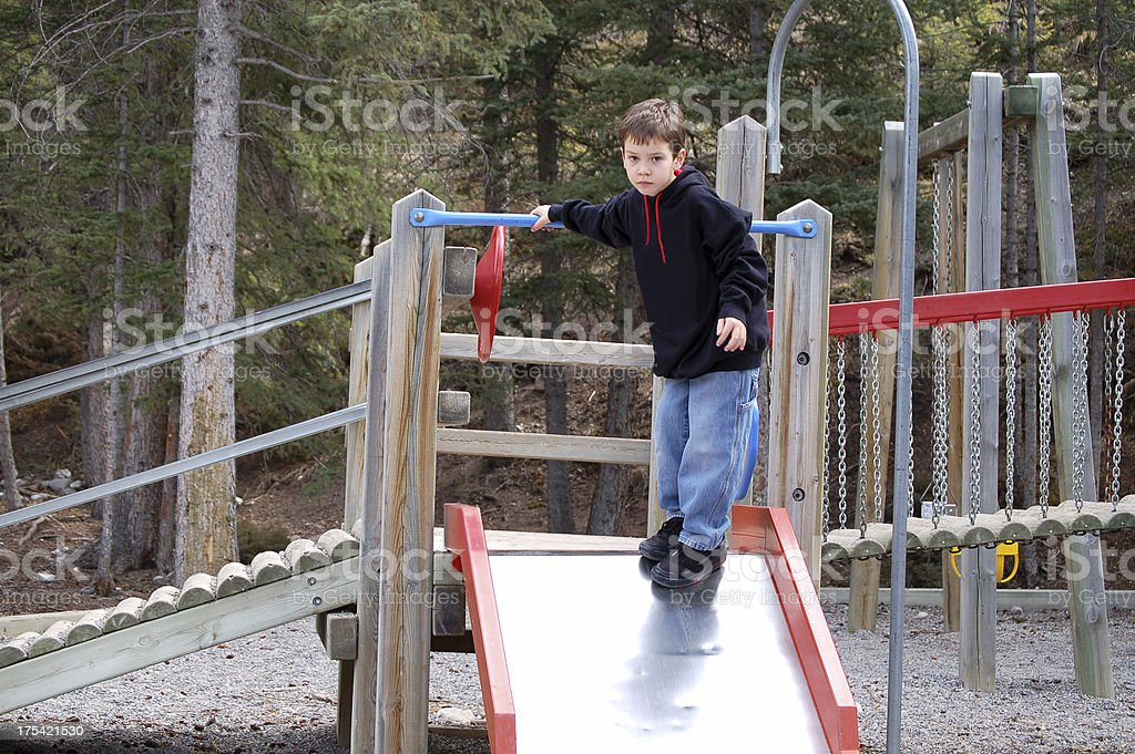 Boy standing at playground alone royalty-free stock photo