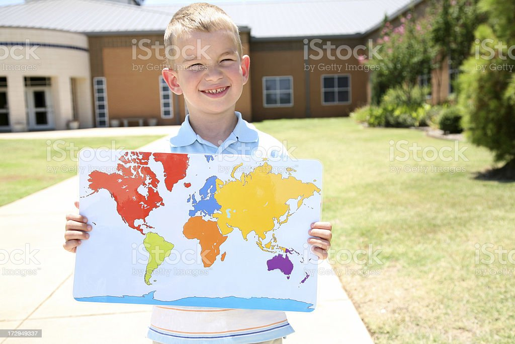 Boy Standing In Front Of His School Holding A Map royalty-free stock photo