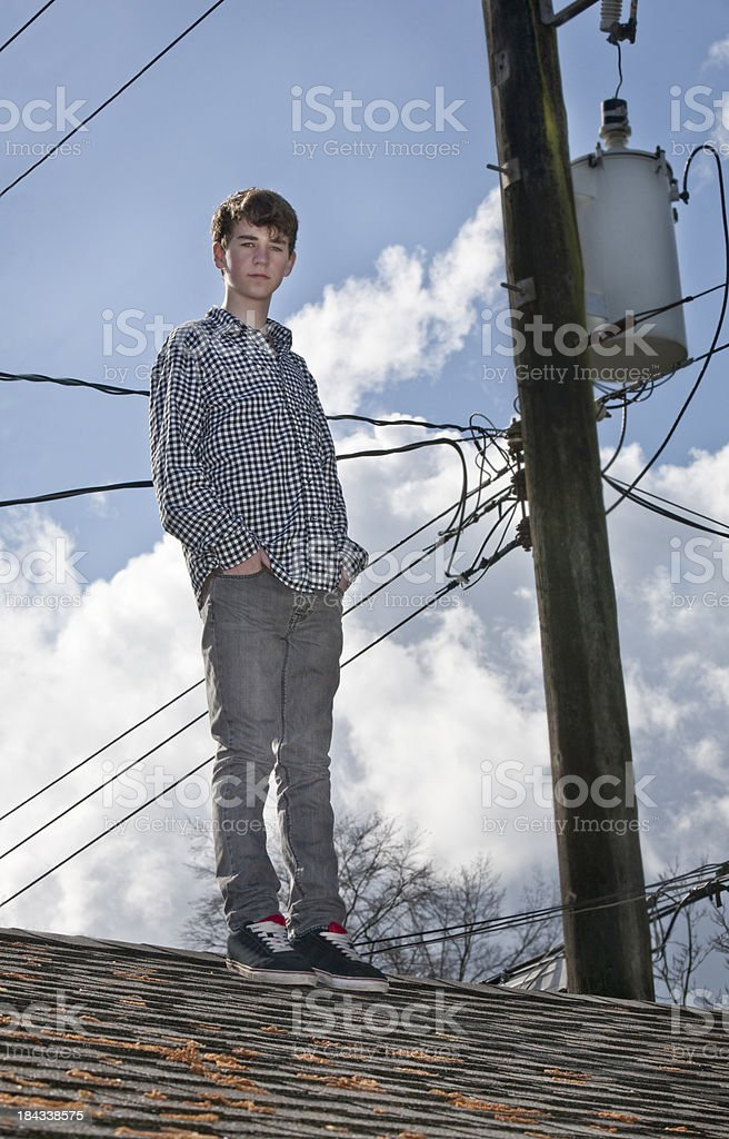 Boy standing on (Garage) Roof stock photo