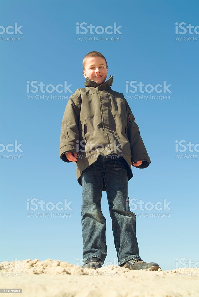 boy standing on the beach royalty-free stock photo