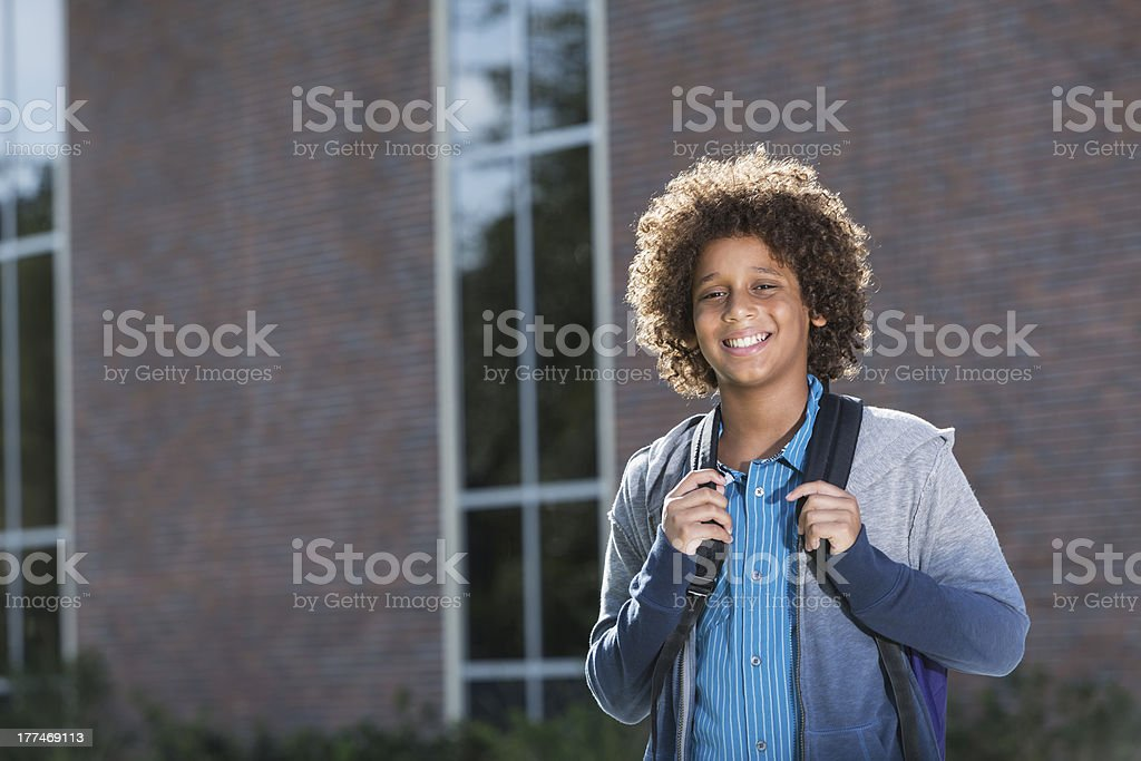 Boy standing outside school royalty-free stock photo