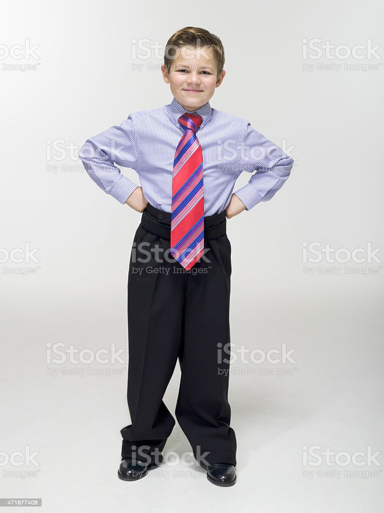 Boy standing with hand on hips stock photo