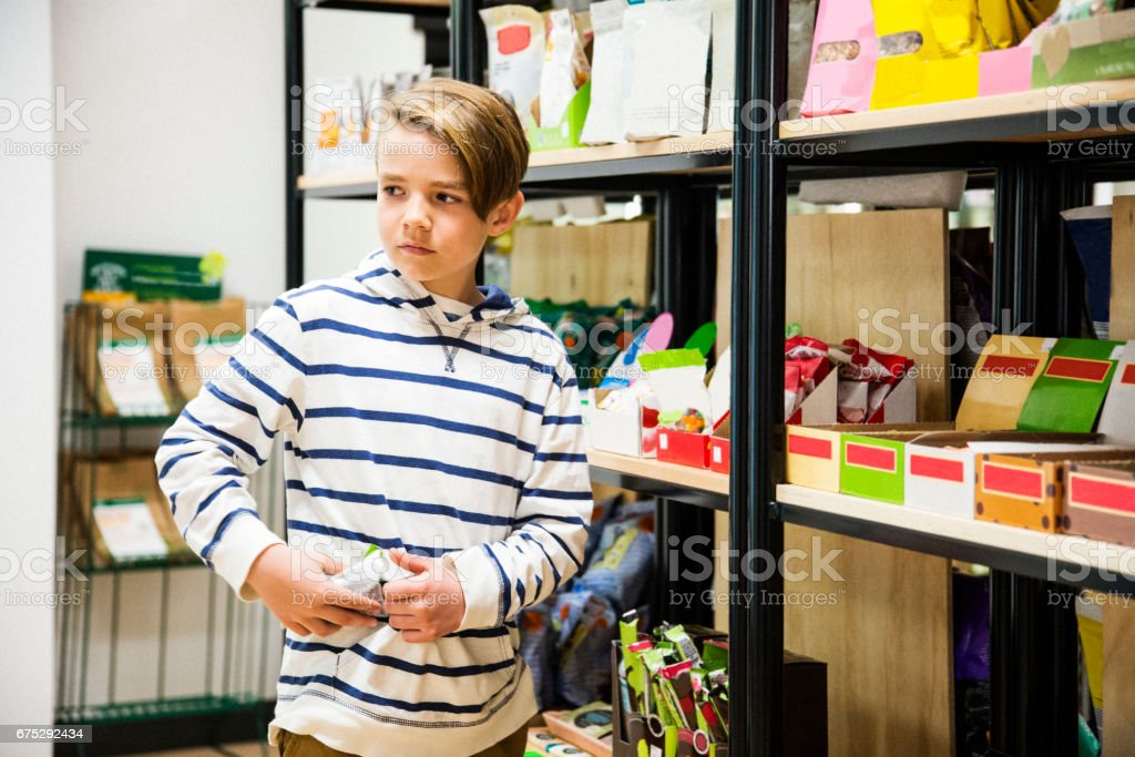 Boy Stealing Candy In A Store stock photo 675292434 | iStock