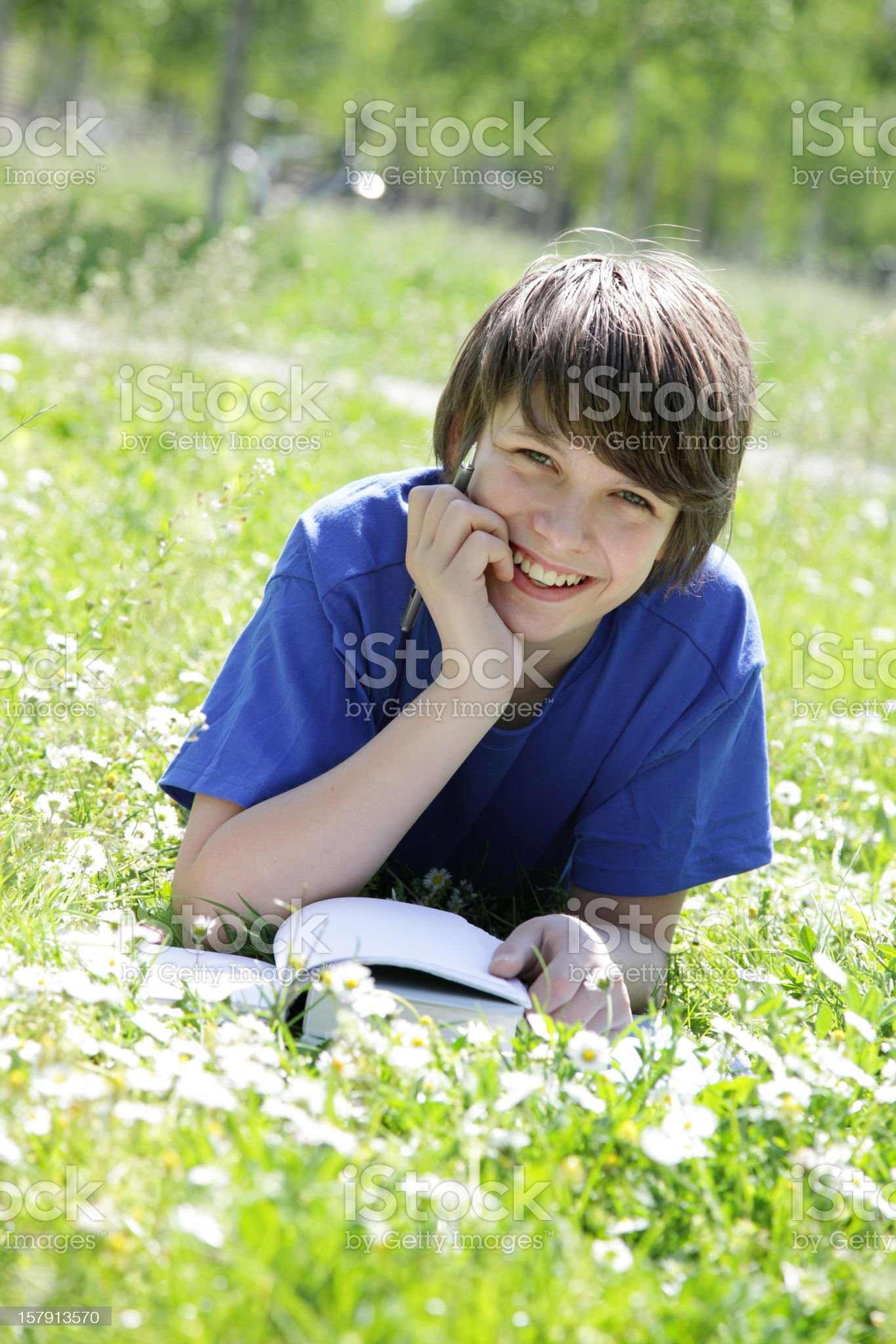 Boy studying in Grass royalty-free stock photo