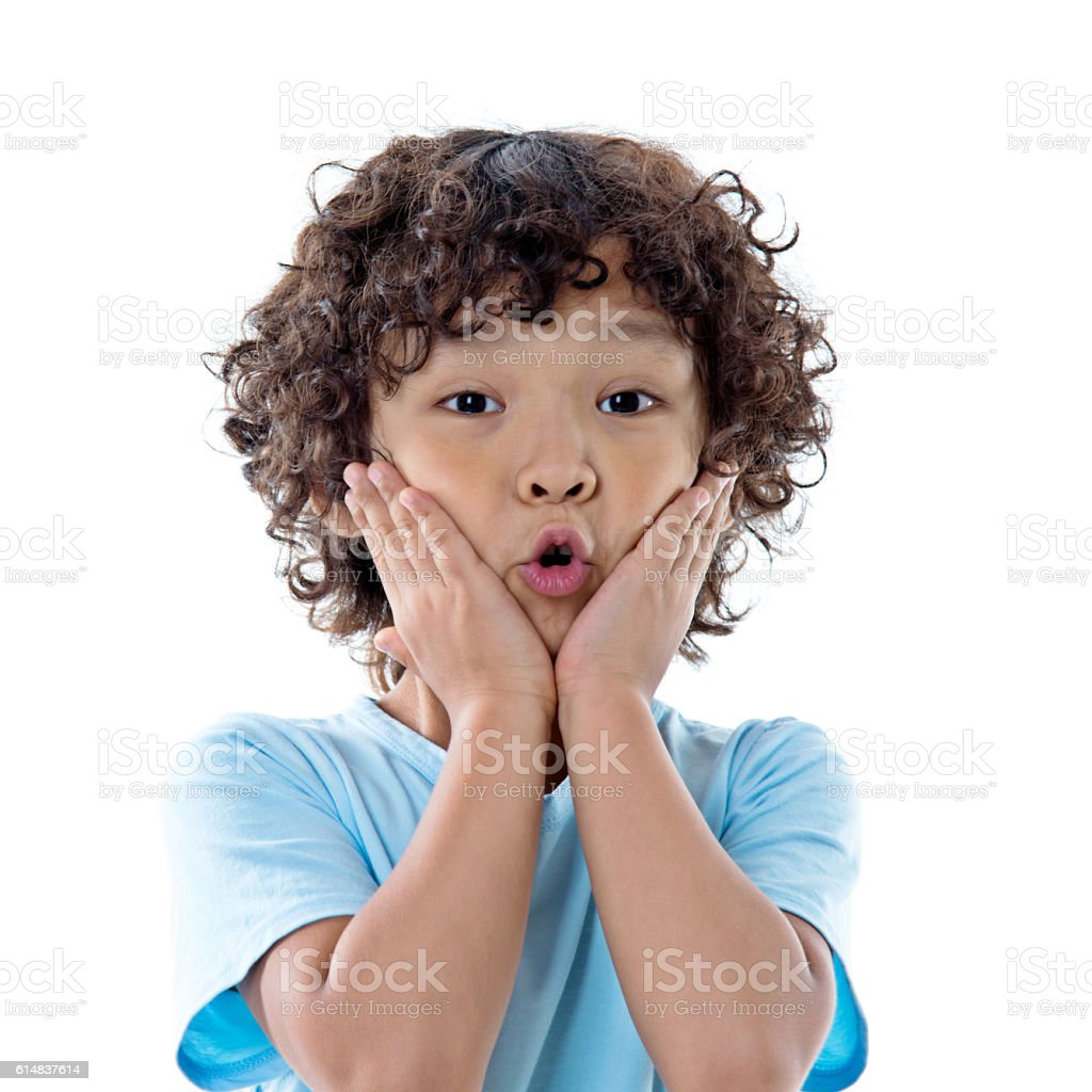 Boy surprised with hands on his mouth stock photo