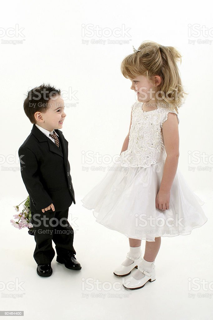 Boy Surprising Girl With Flowers royalty-free stock photo