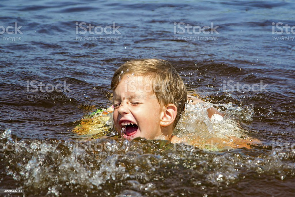 Boy swimming in water royalty-free stock photo