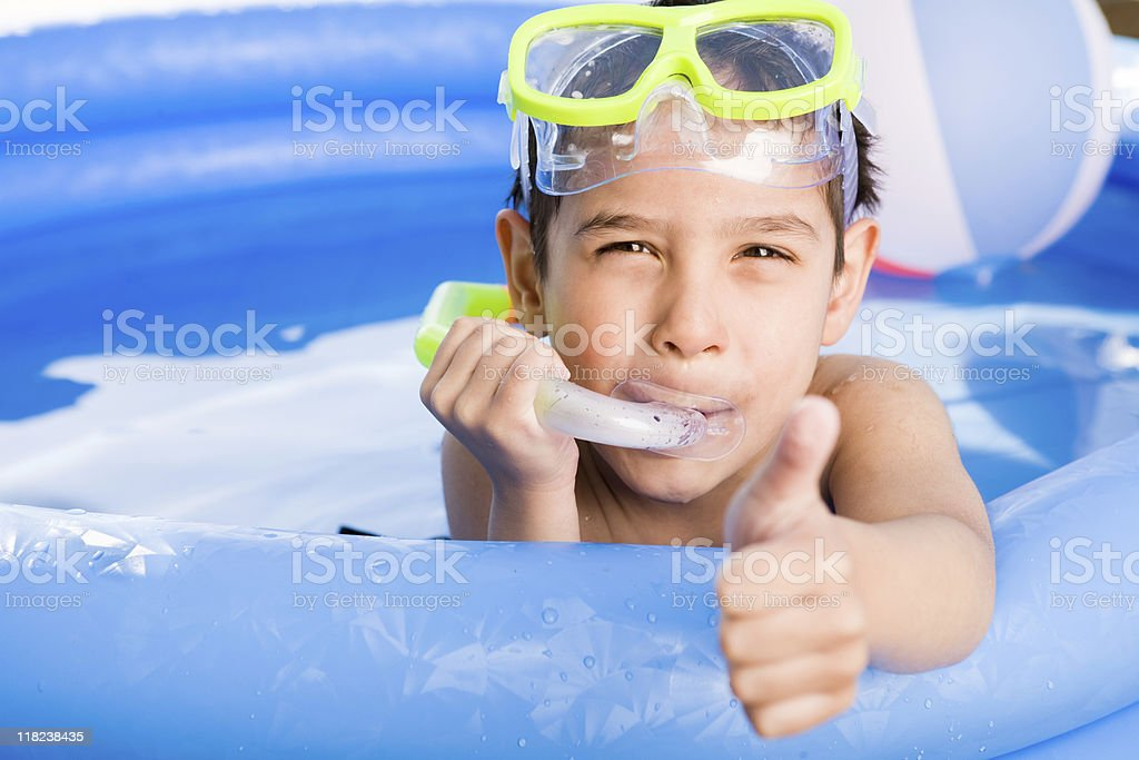Boy swimming outdoor royalty-free stock photo