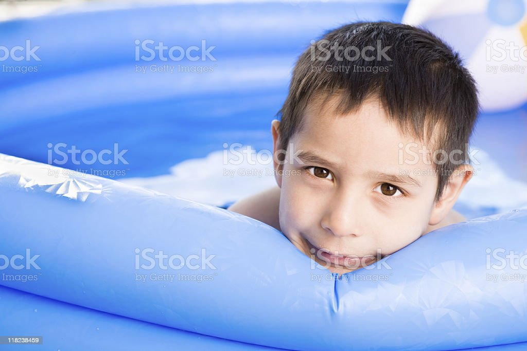 Boy swimming outdoor stock photo