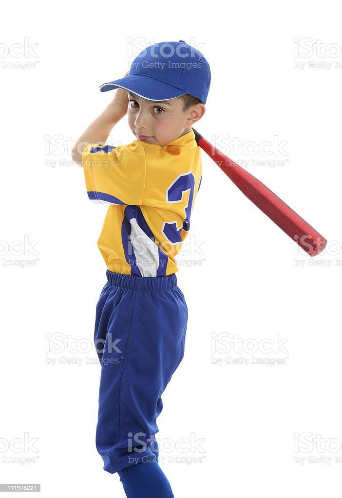 Boy swinging a baseball bat royalty-free stock photo