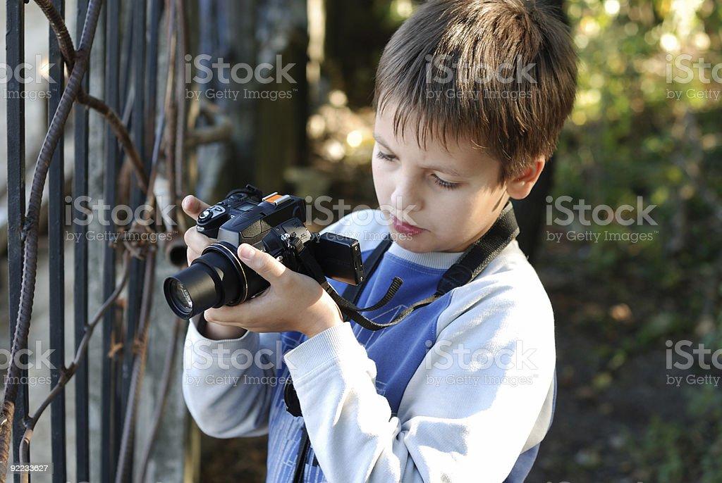 Boy takes a photograph royalty-free stock photo