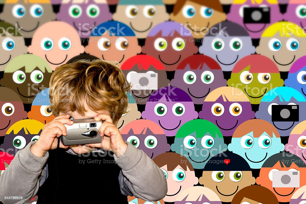 Boy taking a photograph at an event with cartoon crowd stock photo