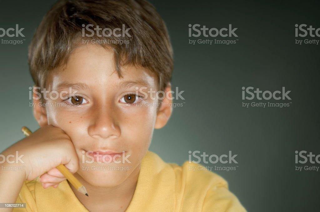Boy Taking Notes at School royalty-free stock photo