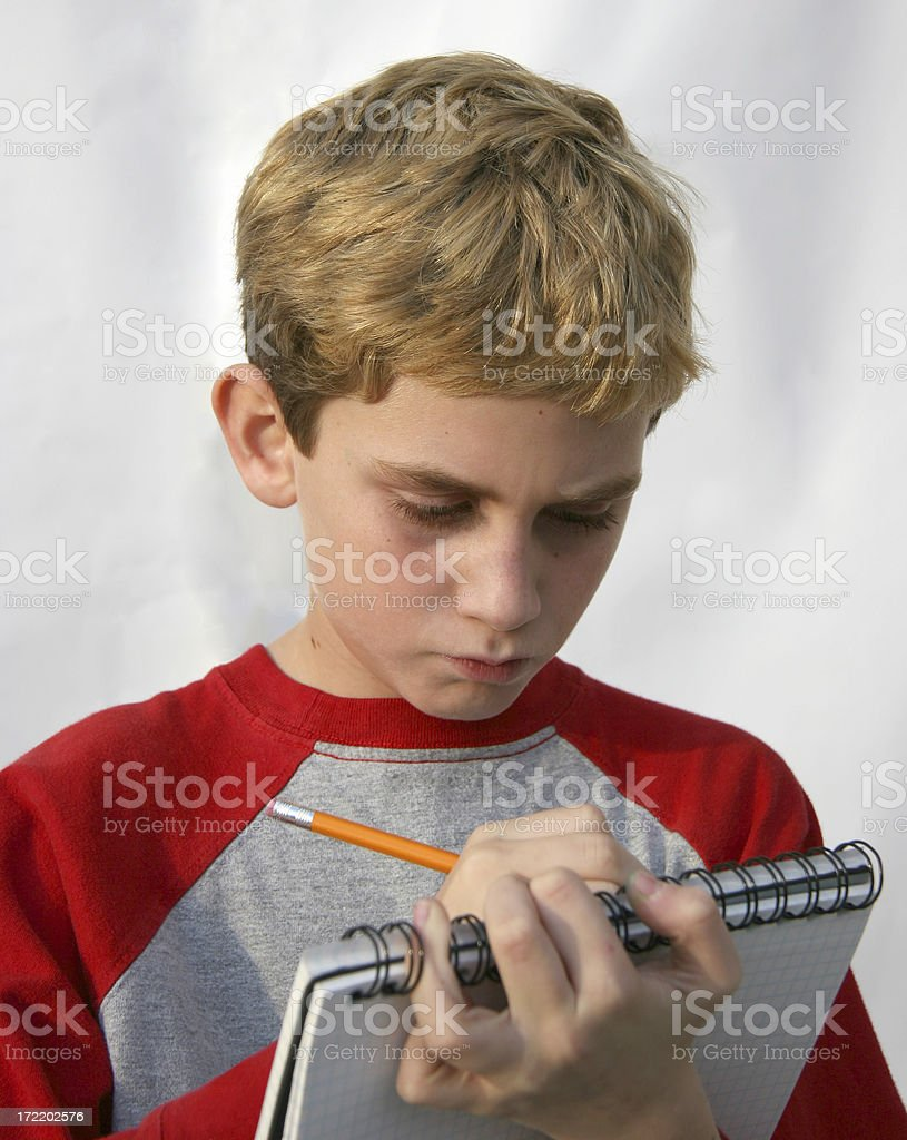 Boy Taking Notes royalty-free stock photo