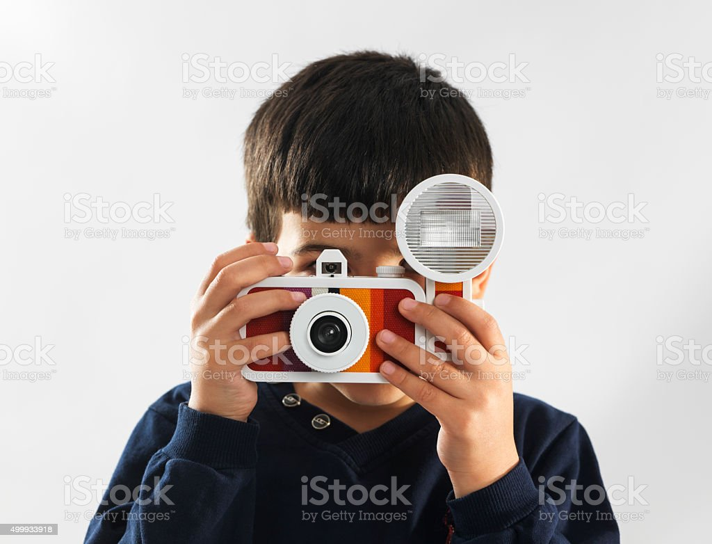 Boy taking photo with a lomo camera stock photo