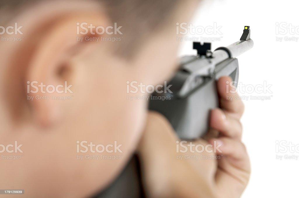 Boy targeting with airgun horizontal stock photo