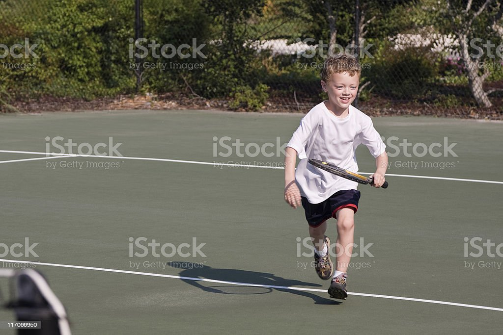 Boy tennis player royalty-free stock photo