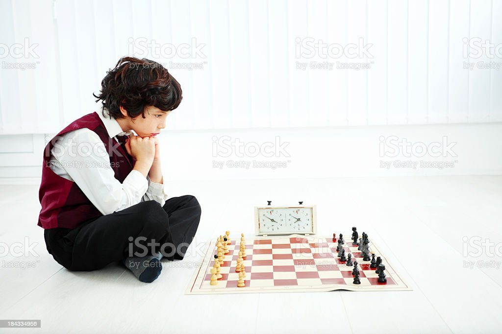 Boy thinking and playing chess. royalty-free stock photo