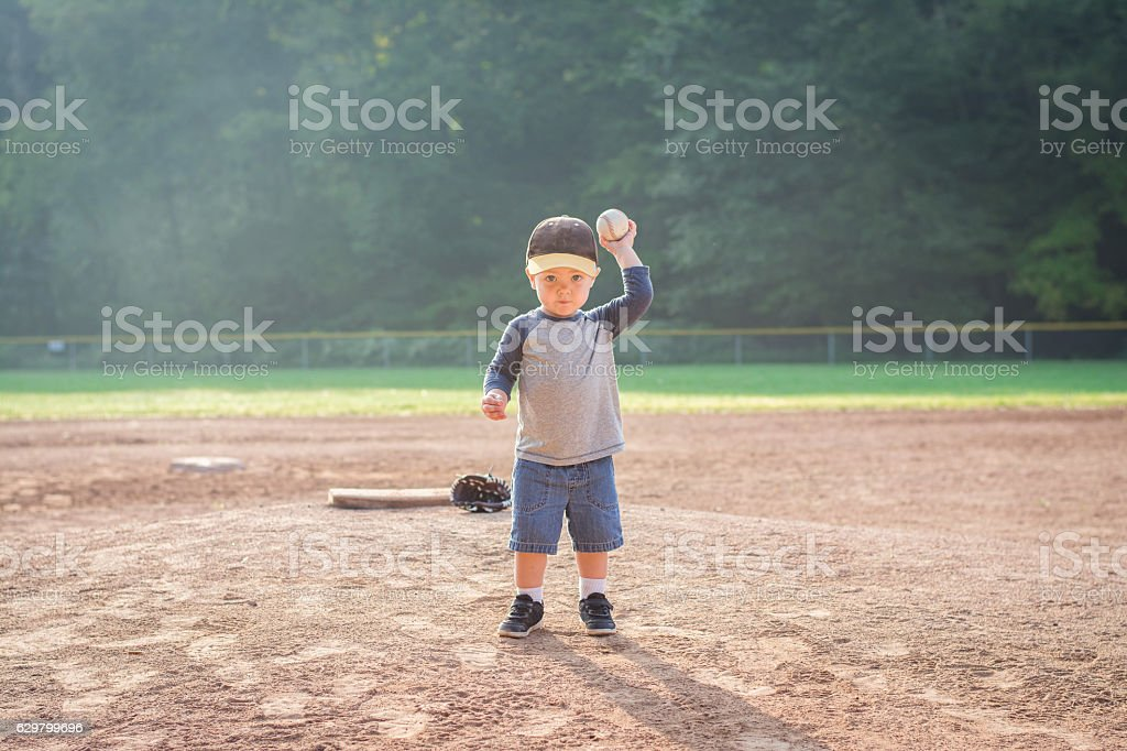 Boy Throwing Baseball stock photo