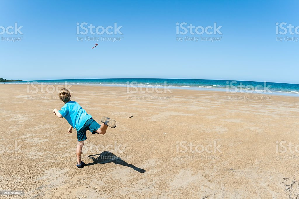 Boy Throwing Boomerang Beach stock photo