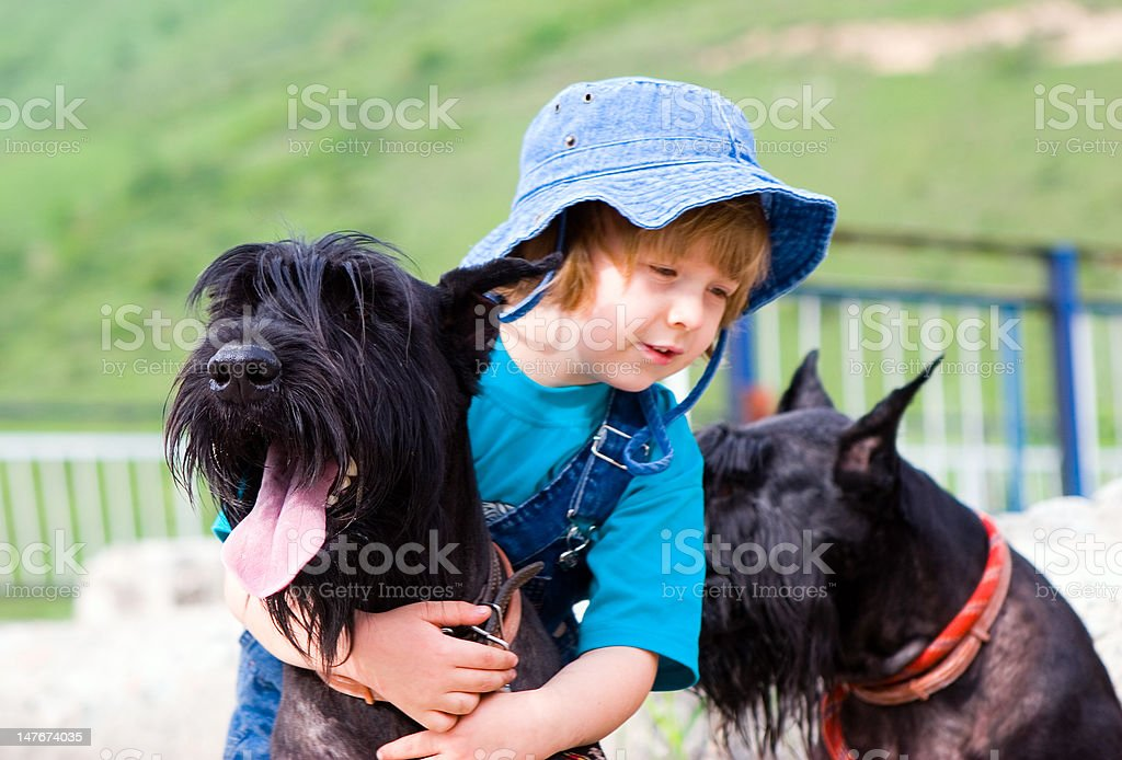 Boy to ride by dog (series Children and Animals) royalty-free stock photo