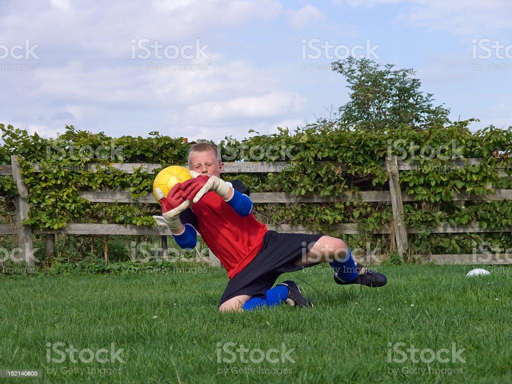Boy training goalkeeping stock photo