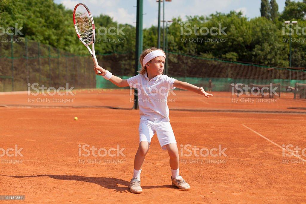 boy training tennis stock photo