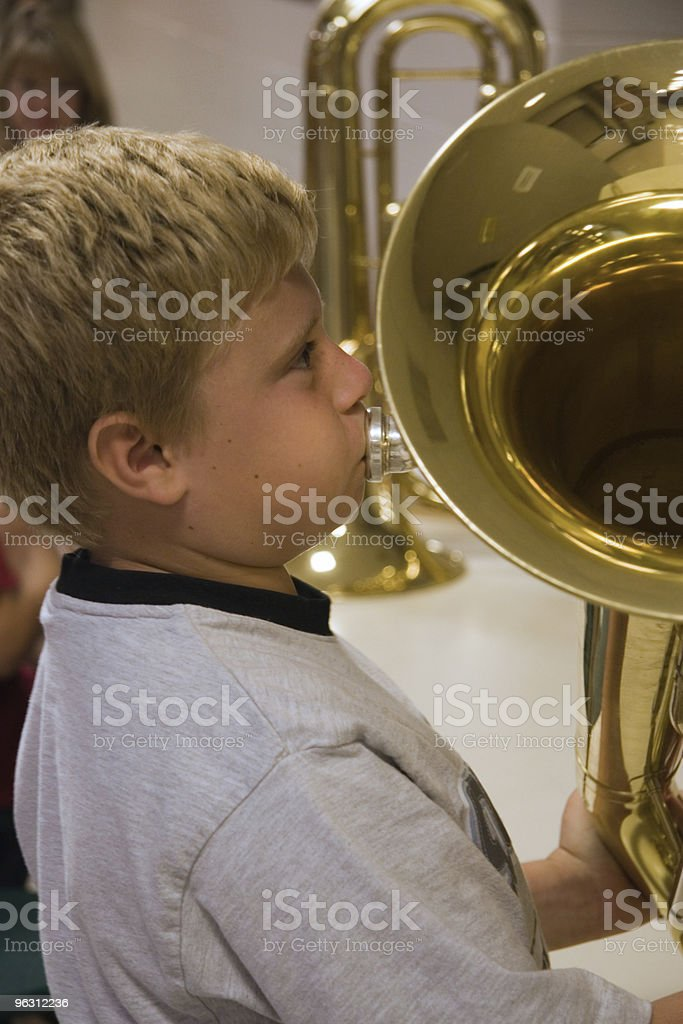 Boy Trying Out His First Instrument stock photo