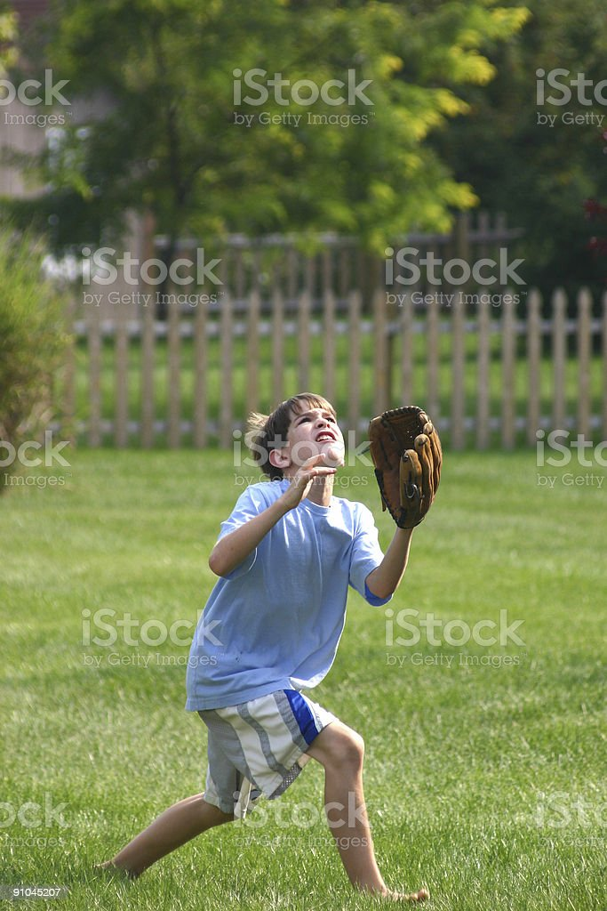 Boy Trying to Catch Ball stock photo