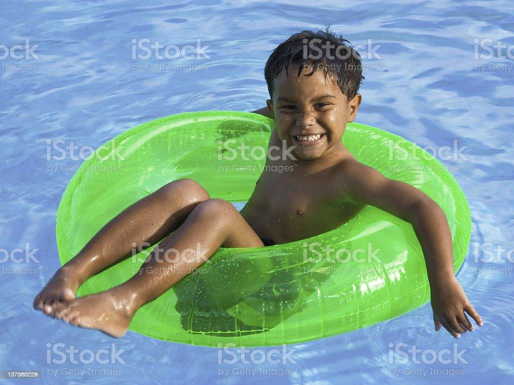 boy tubing in the sun stock photo