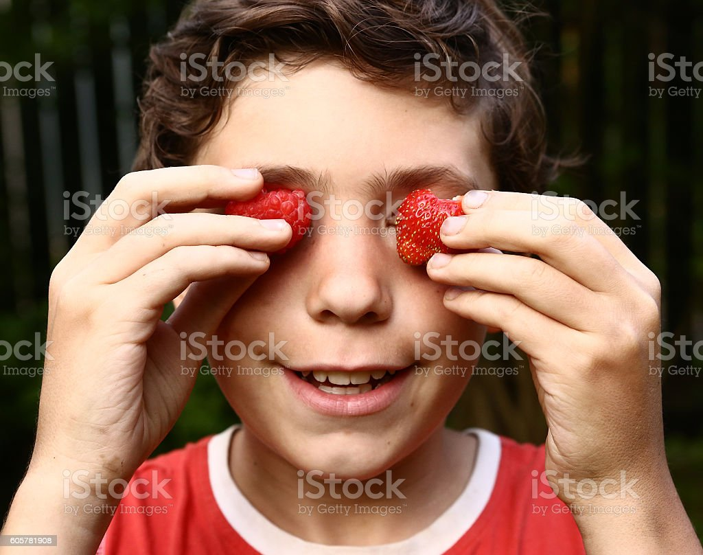 boy up portrait with strawberries stock photo