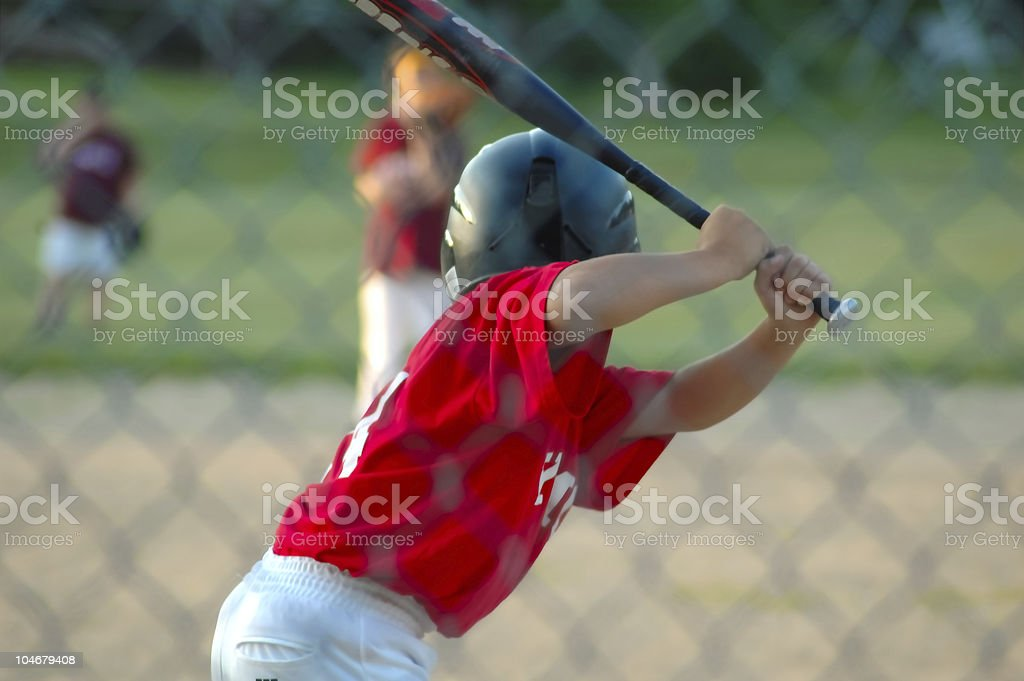 Boy up to bat in baseball game stock photo