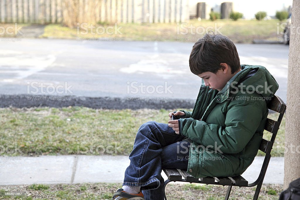 Boy Using a Mobile Device royalty-free stock photo