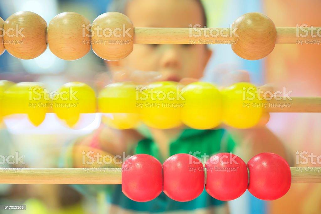 Boy using abacus stock photo