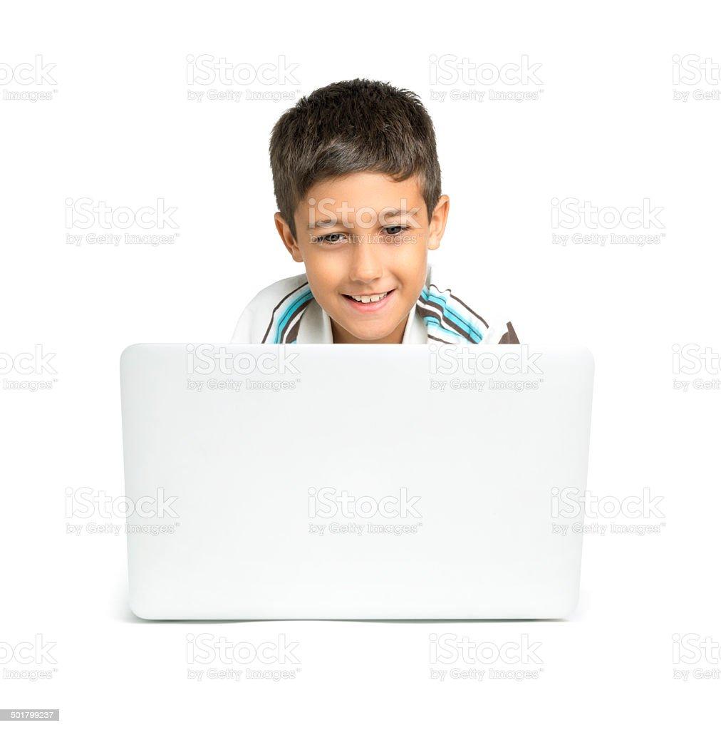 Boy using laptop stock photo