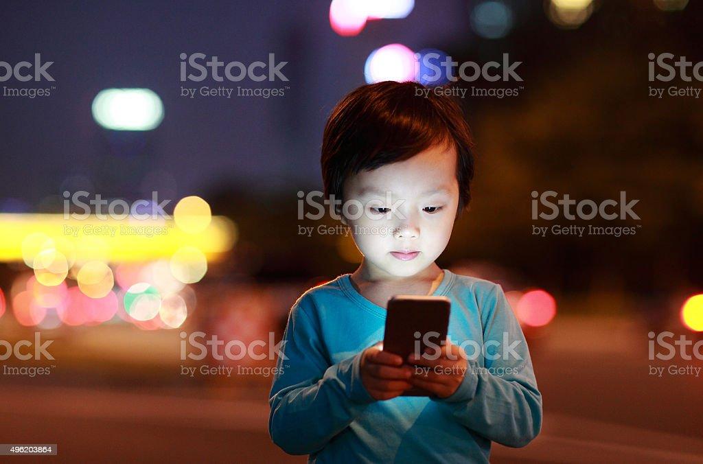 Boy Using Smart Phone stock photo