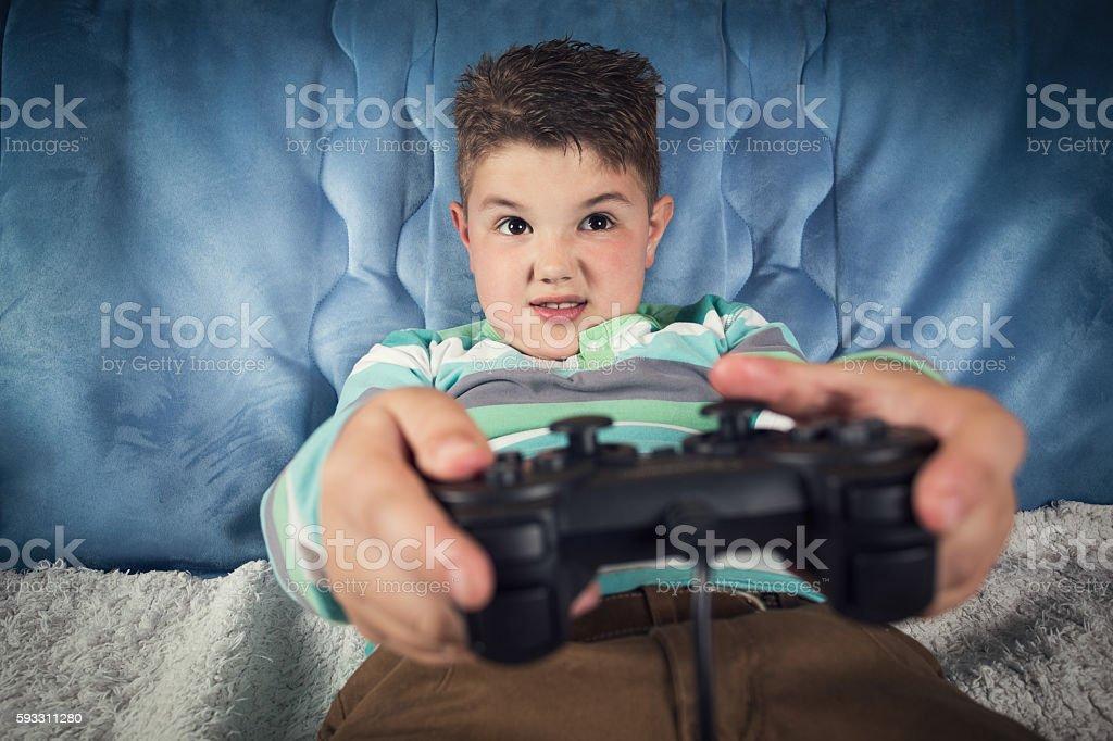 Boy using video game controller stock photo
