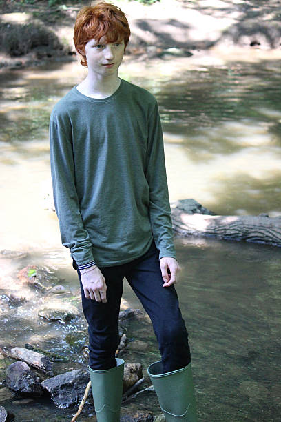 Wet Teenage Boy In The Woods Pictures Images And Stock