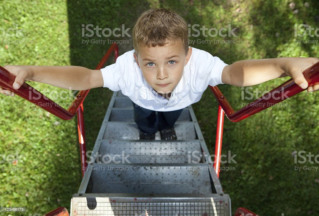 Boy waiting for his turn on a slide royalty-free stock photo