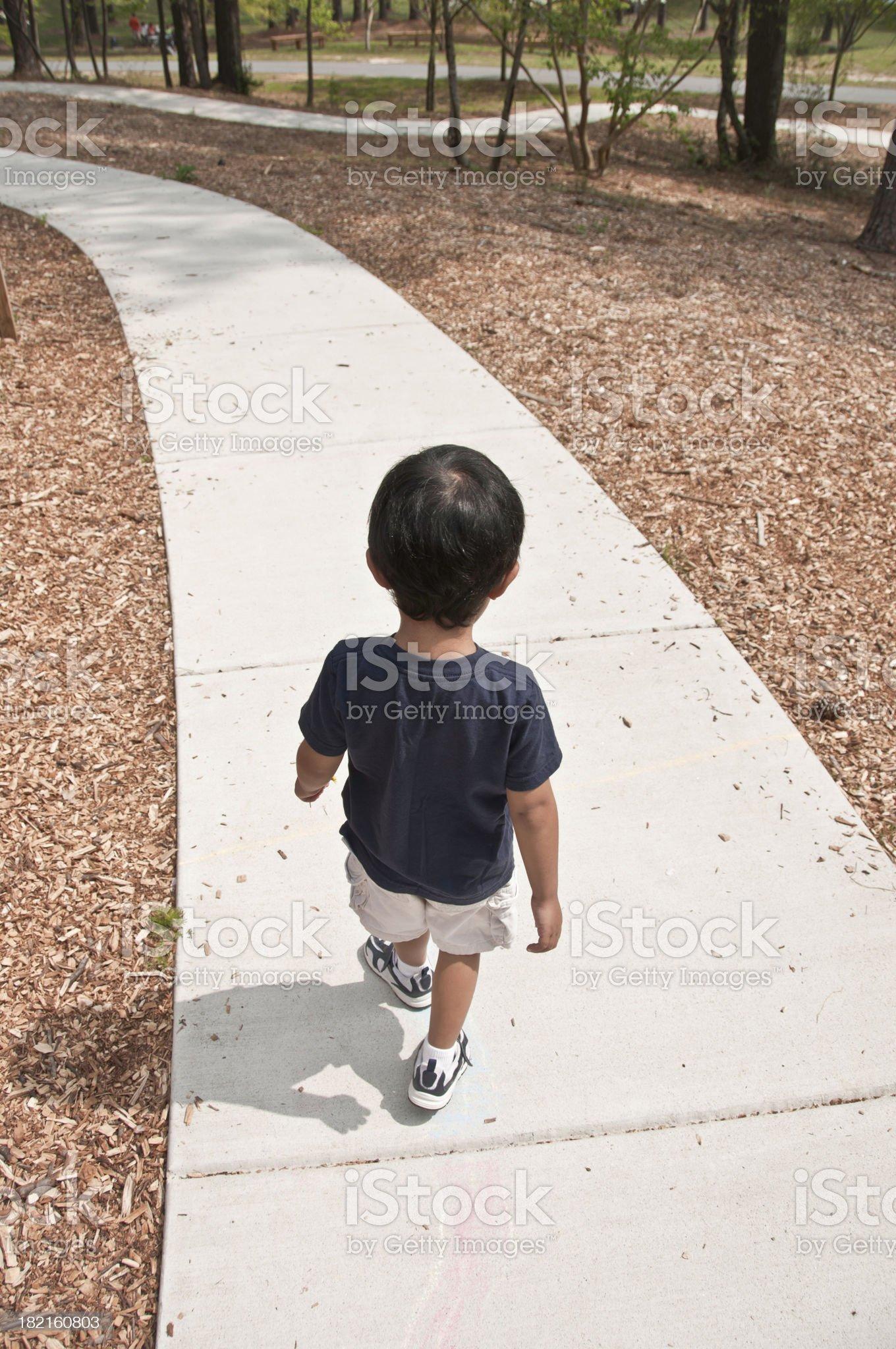 Boy Walking on the path royalty-free stock photo