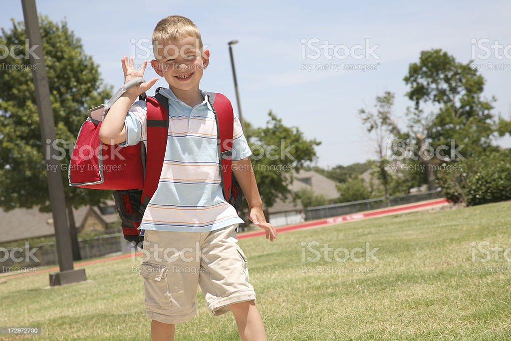 Boy walking to school royalty-free stock photo