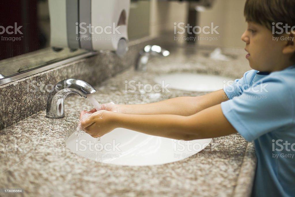 Boy washing hands stock photo
