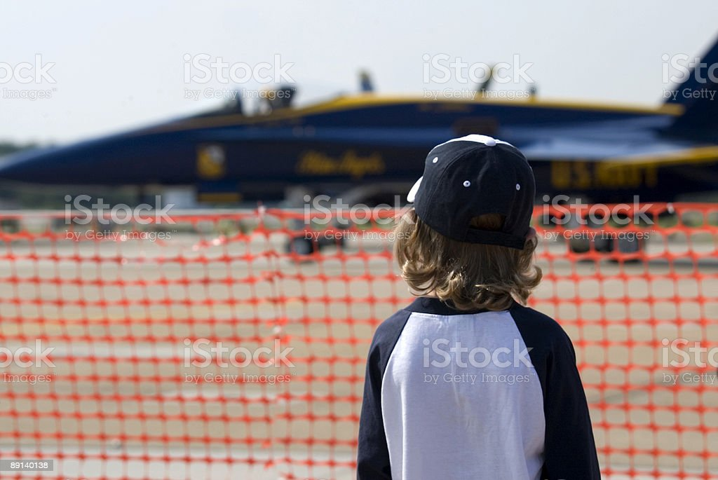 Boy watching fighter jet royalty-free stock photo